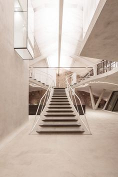 Vienna studio Smartvoll was appointed following an international competition to oversee the design of an apartment that occupies the building's 350-square-metre roof space.