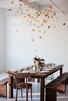 Really beautiful way to decorate for a fall gathering. Use leaves and fishing line to decorate the space to resemble falling leaves.