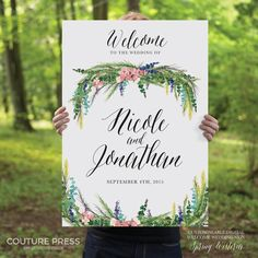 The Spring Wisteria Wedding Welcome Sign from Couture Press features a gorgeous watercolour image paired with a whimsical modern calligraphy font