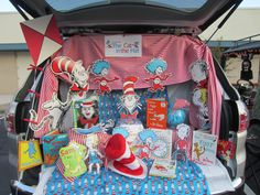 Cat in the Hat Trunk or Treat - I used our collection of Dr. Seuss books and I had the Cat in the Hat fabric and the red/white striped fabric on hand.  The Cat in the Hat cut-outs came from our local teacher supply store (it was a bulletin board kit).