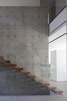 Concrete panels, wood and glass