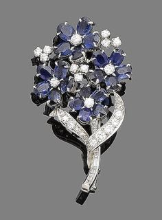 Sapphire Brooches A sapphire and diamond flower brooch, by Cartier, circa The stem set with baguette-cut diamonds, to four flowerheads, the petals set Cartier Jewelry, Gems Jewelry, Bling Jewelry, Jewelry Accessories, Jewelry Design, Silver Jewellery, Antique Jewelry, Vintage Jewelry, Diamonds