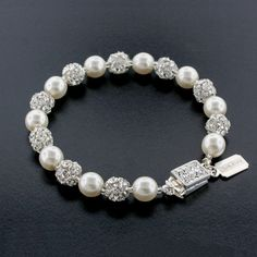 """Pearl bracelet with prong-set crystal beads and decorative box clasp.  7.5"""" long."""