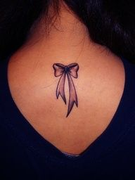 I'm thinking of a bow tattoo. A red one, and possibly on my neck, thigh or pelvic area.