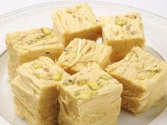Soan Papdi is one of the famous Indian desserts. It is one of the Diwali sweet w. Soan Papdi is one of the famous Indian desserts. It is one of the Diwali sweet which melts in the mouth leaving its Indian Dessert Recipes, Indian Sweets, Indian Snacks, Köstliche Desserts, Sweets Recipes, Cooking Recipes, Comida India, Desi Food, Profiteroles