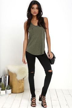 Take The Racer Washed Olive Green Tank Top around the track, and you'll see it's a clear winner! Burnout jersey knit shapes this classic tank with a V-neck, racerback, and patch pocket. Rounded hem finishes off the relaxed bodice.