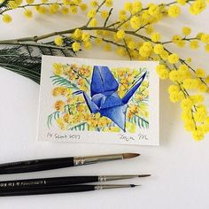 Paper crane no. 24 - Watercolour ACEO of blue origami paper crane & yellow wattle by Zoya Makarova