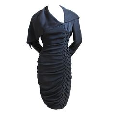 Black silk dress with unique 'braided' detail and large draped collar designed by Bruce Oldfield   United Kingdom, 1980-2000