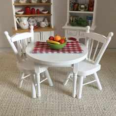 White Round Table and Two Chairs with Reversible Placemat and Bowl of Fruit for 1:12 Scale Dollhouse (additional chairs available) by Trishiesminicorner on Etsy https://www.etsy.com/listing/475100653/white-round-table-and-two-chairs-with