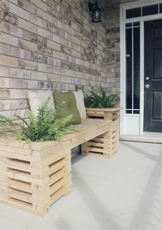 Build your own bench out of wood. Add plants and pillows and your front porch will be looking fab in no time!