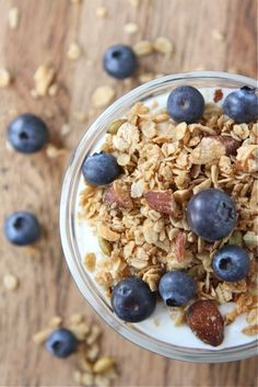 Coconut Granola made with coconut oil! Recipe on twopeasandtheirpod.com This granola is the BEST and easy to make at home!