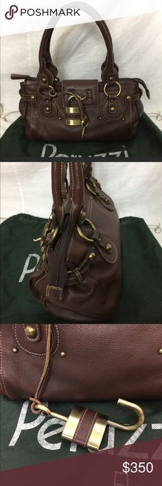 Chloe Style Peruzzi Shoulder Bag 💼 Beautiful chocolate brown artistry in 100% Italian leather. Looks just like a Chloe without the Chloe price tag. This is a medium sized bag that can be comfortably carried over your shoulder or on your arm. Comes with dust bag as well as a functional lock and key. TV 700 Peruzzi Bags Shoulder Bags