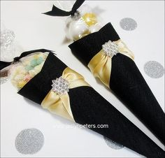 Our hand made, black silk shantung wedding favor cones will add a touch of timeless elegance to your decor! Package your confetti, candy, bridesmaid's gifts or