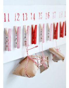 Advent calendar clothsline- cute, functional, and out of the way  Auf spagat, eingefädelt in die sterne der metallkappe des SilenTree und schon hat man einen adventsbaum