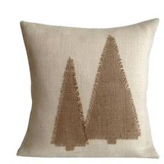 """Eco-friendly burlap pillow with an evergreen tree motif and feather-down fill. Made in the USA.  Product: PillowConstruction Material: Burlap and 95/5 down feather fillColor: NeutralFeatures:  Made in the USAInsert includedEco-friendly Dimensions: 20"""" x 20""""Cleaning and Care: Spot clean"""