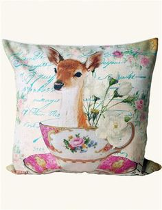 A vibrant watercolour of a doe nestled in a teacup is screen printed upon a flaxen weave pillow sham.