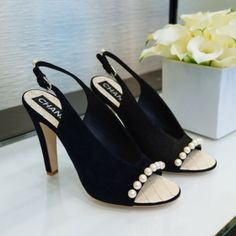 Chanel slingbacks with pearls