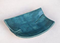 Ceramic soap dish - hand formed from white clay. Finished with turquoise sandy glossy glaze.  It has rectangle shape.  Size: 12cm x 8cm  I used nontoxic, dinnerware-safe glaze.  Optional you can combine it with your own choice of Elixirio soap to make a beautiful gift. You can choose to buy here: https://www.etsy.com/shop/Elixirio?section_id=11320553&ref=shopsection_leftnav_1  It can also be used as a spoon, teabag rest, jewelry bowl or candle holder.