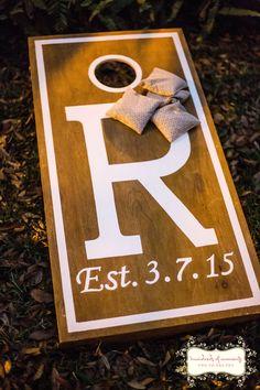 Personalized cornhole game for wedding reception.