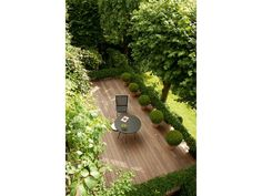 Un jardin en pente plein de vie | Jardin de ville, Banlieue et ...