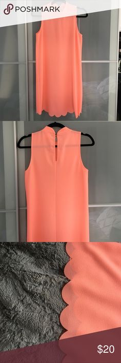 Scalloped Dress Crew neckline with button fasten. Bright salmon pink colored. Scalloping on the bottom. Size small Dresses Mini