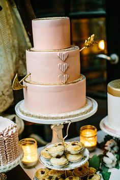 pink wedding cake - photo by A Brit and A Blonde http://ruffledblog.com/creative-toronto-wedding-with-stylish-backdrops