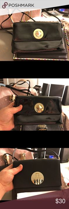 Black Kate Spade Crossbody Small black Kate Spade Crossbody  Gold hardware  Cute little bag/purse Great condition- minus some small scratches scuffs on front closing hardware from turning to close. Still cute kate spade Bags Crossbody Bags