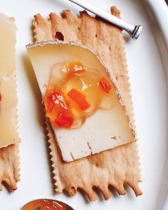 Ooh, we love pepper jelly, a spicy-sweet match for soft cheeses, such as goat or Camembert (or even cream cheese) -- especially when served atop crackers or crostini. You can also use the jelly as a glaze for chicken or pork: Melt it, then brush it on the meat before roasting or after grilling.