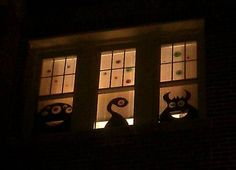 monster cut-outs in windows, I have done this before with black contact paper. Easy and looks great!