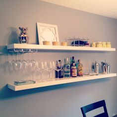 Easy DIY bar using $20 Ikea shelves via www.livingwithaboy.com Floating Bookshelves, Industrial Floating Shelves, Floating Shelves Bedroom, Floating Shelves Kitchen, Floating Shelves With Lights, Rustic Floating Shelves, Ikea Lack Regal, Ikea Wall Shelves, Shelf Desk
