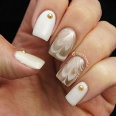 """Nails - Watermarble using China Glaze """"Dandy Lyin' Around"""" and Essie """"Good As Gold"""" and """"As Gold As It Gets"""" on the thumb --- Instagram @majikbeenz"""