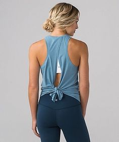 The All Tied Up Tank was designed to wear  two ways: layer it on long and loose or tie up the back to secure in place during yoga class.