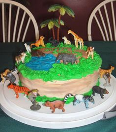 Easy cake. Buttercream frosting with plastic jungle animal set. Got to eat the cake and play with the animals too!