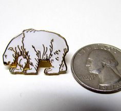 Vintage Polar Bear Gold Tone and Enamel Pin / Lapel Pin / Hat Pin, Costume Jewelry by VINTAGEandMOREshop on Etsy https://www.etsy.com/listing/236138676/vintage-polar-bear-gold-tone-and-enamel