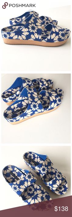 """Alice + Olivia Blue Bird Flower Slide Sandals Features: -double strap across foot -wooden platform -rounded toe -rubber outsole -leather backing -Floral bird print canvas upper -comes with original dust bag  Materials: -Canvas -wood -leather -rubber  Sizing: -European sizing, 40 -US Sizing, 10 -10.5"""" insole length -2"""" platform  Condition: -natural wear due to storage, otherwise great condition  VW.0617.B15. Alice + Olivia Shoes Sandals"""
