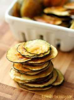 Zucchini Chips - slice very thin and press between sheets of paper towels to remove moisture. Line up on a baking sheet and brush with olive oil, sprinkle w salt. Bake at 225 for 2 hours till they dry and crisp...jpg