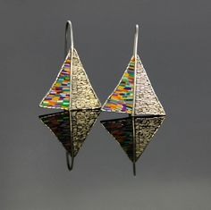 Elvira López Del Prado Rivas' beautiful earrings that include a polymer clay mosaic section.