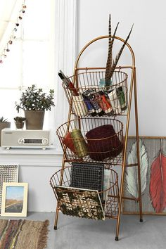 Ladder Storage Basket - Urban Outfitters Maybe for the extra towls in the bathroom if there's room..