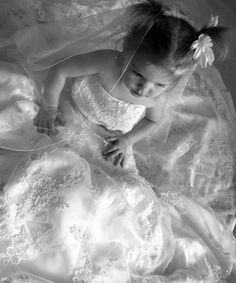Photograph your little girl in your wedding dress and give her a copy on her wedding day | The Brighter Writer