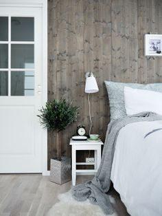 Love the look of this room - wooden flooring and wooden walls