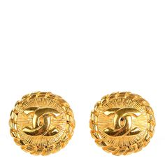 This is an authentic CHANEL Vintage CC Clip On  Earrings in Gold. These earrings have a bold, classical look with a rings of textured gold metal surrounding a central raised Chanel CC. These are a marvelous pair of clip on earrings for a look of timeless quality and style only from Chanel!