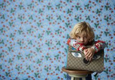 Accessories from the new Gucci children's collection: the GG Supreme cat messenger