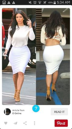 Kim Kardashian in a pencil skirt & crop top .