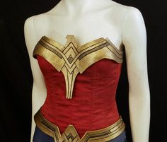 For DIY-minded folks interested in assembling their own Wonder Woman bodice, this is the gold neckline detailing, modeled after the stylized eagle that graces Gal Gadots costume in Batman v Superman and the upcoming Wonder Woman movie. This listing is for the golden eagle *ONLY* -- this is not ready-to-wear! The bodice/corset is not included and not available through Armory Rasa, so you will need your own corset and some ingenuity to put it together. The eagle should fit onto most overbu...