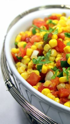 HEAT and SWEET CORN SALSA... A summer side dish should be easy and this one certainly is. Just open a few cans, mix in whatever you can with fresh ingredients and herbs add a few seasonings and you are done. It is served chilled, so no cooking involved. But, my oh my, the summer freshness, colors and deliciousness shines through.  I LOVE the mix of SPICY PEPPERS AND SWEET HONEY in THIS EASY EASY EASY DISH!