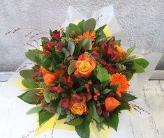 Seasonal autumn handtie bouquet in orange Roses, Germinis and Lanterns, and red Alstromeria and berries. Orange Roses, Hanging Lanterns, Berries, Floral Wreath, Wreaths, Seasons, Table Decorations, Autumnal, Bridal Bouquets