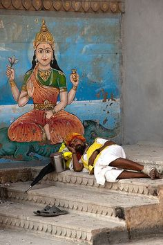 Sleeping sadhu with shoes off by dick verton