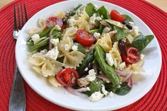 greek pasta salad with chicken, feta, kalamata olives, artichoke hearts, tomatoes and red onions