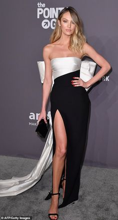 Bows and arrows: Candice Swanepoel looked like a gift wearing a sultry monochrome number with an over the top bow on the back
