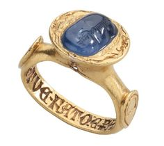 Medieval Inscribed Sapphire Ring  ~  Italy, late 14th century; sapphire with Islamic inscription, 10th century?